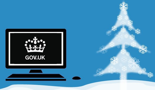 GOV.UK crown logo on a laptop with a christmas tree