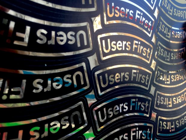 Stickers with 'users first' written on them