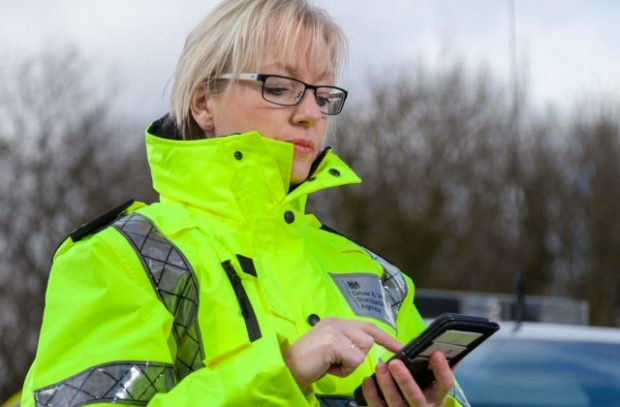 A traffic examiner using a smartphone