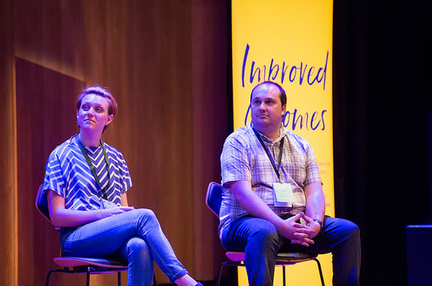 Photo of Kate Ivey-Williams and John Ploughman sat on chairs on a stage.