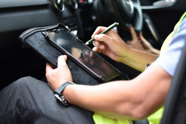 Driving examiner using a tablet